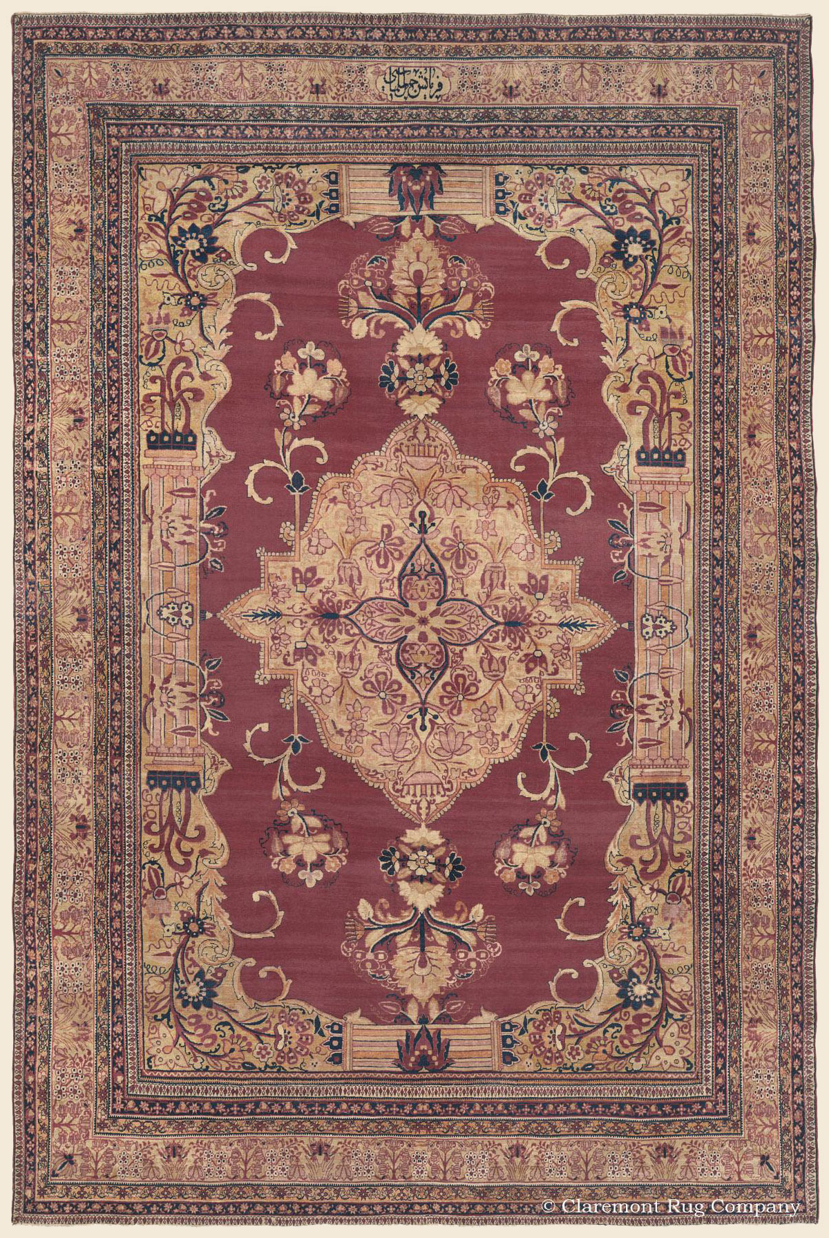 Room Size Laver Kirmanantique persian rug with large floral medallion on an abrash cranberry ground