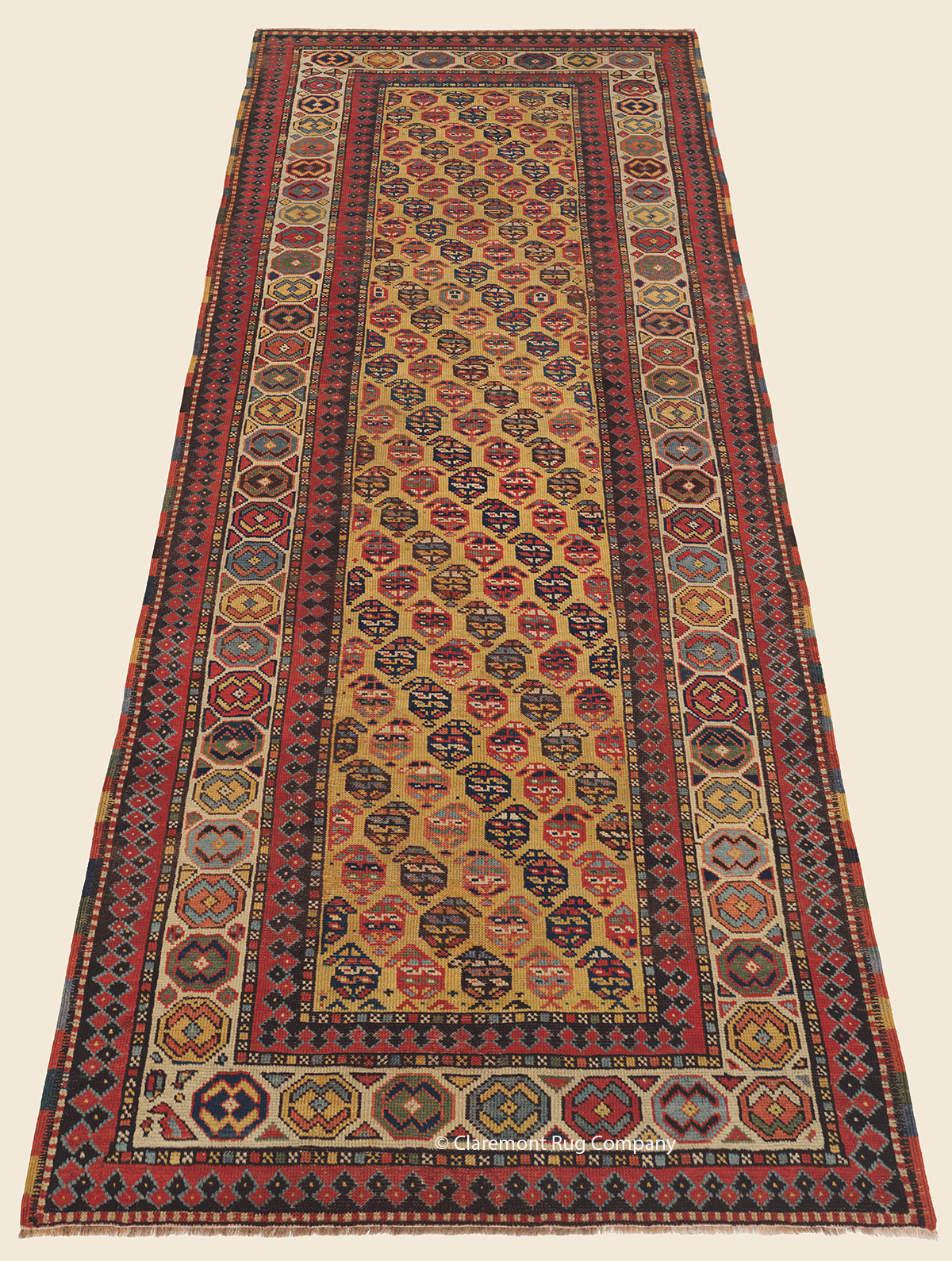 Caucasian Gendje Antique 19th century Oriental Runner Rug with Saffron field and crafted borders