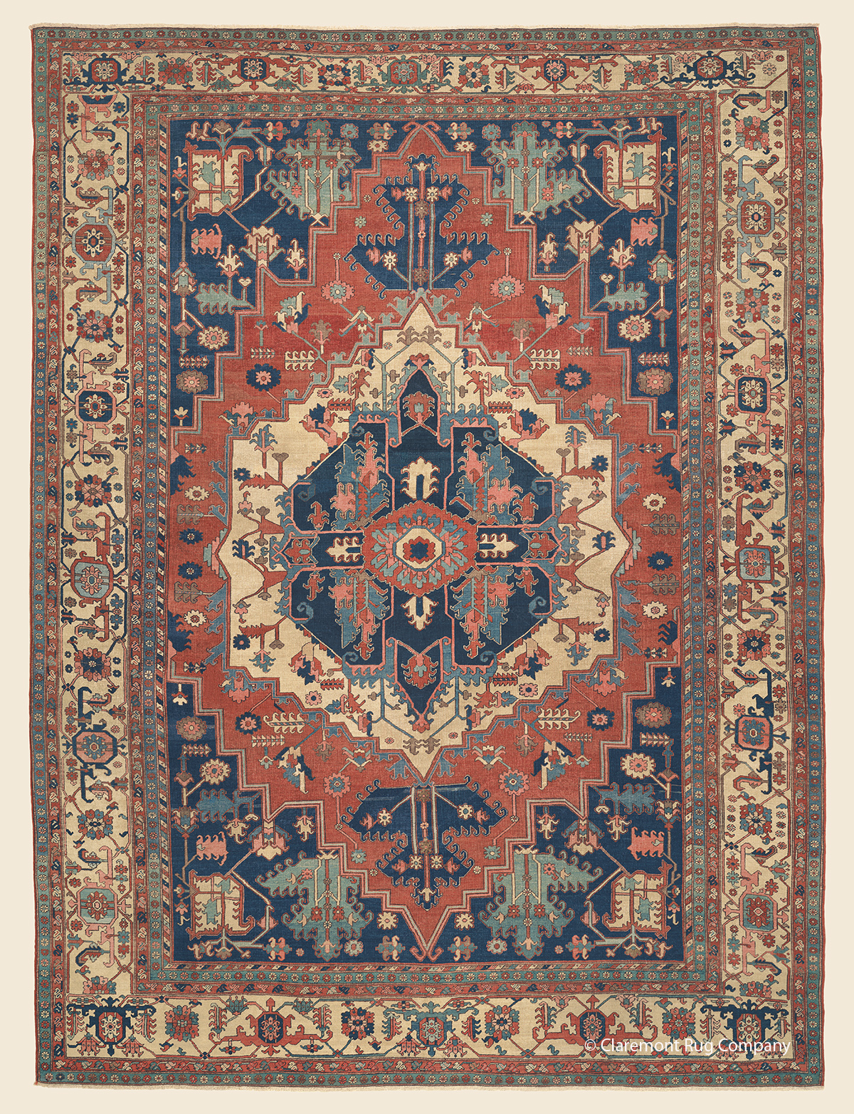 Serapi antique Oriental rug with ivory border and blossom and vine motif on an abrash red reserve