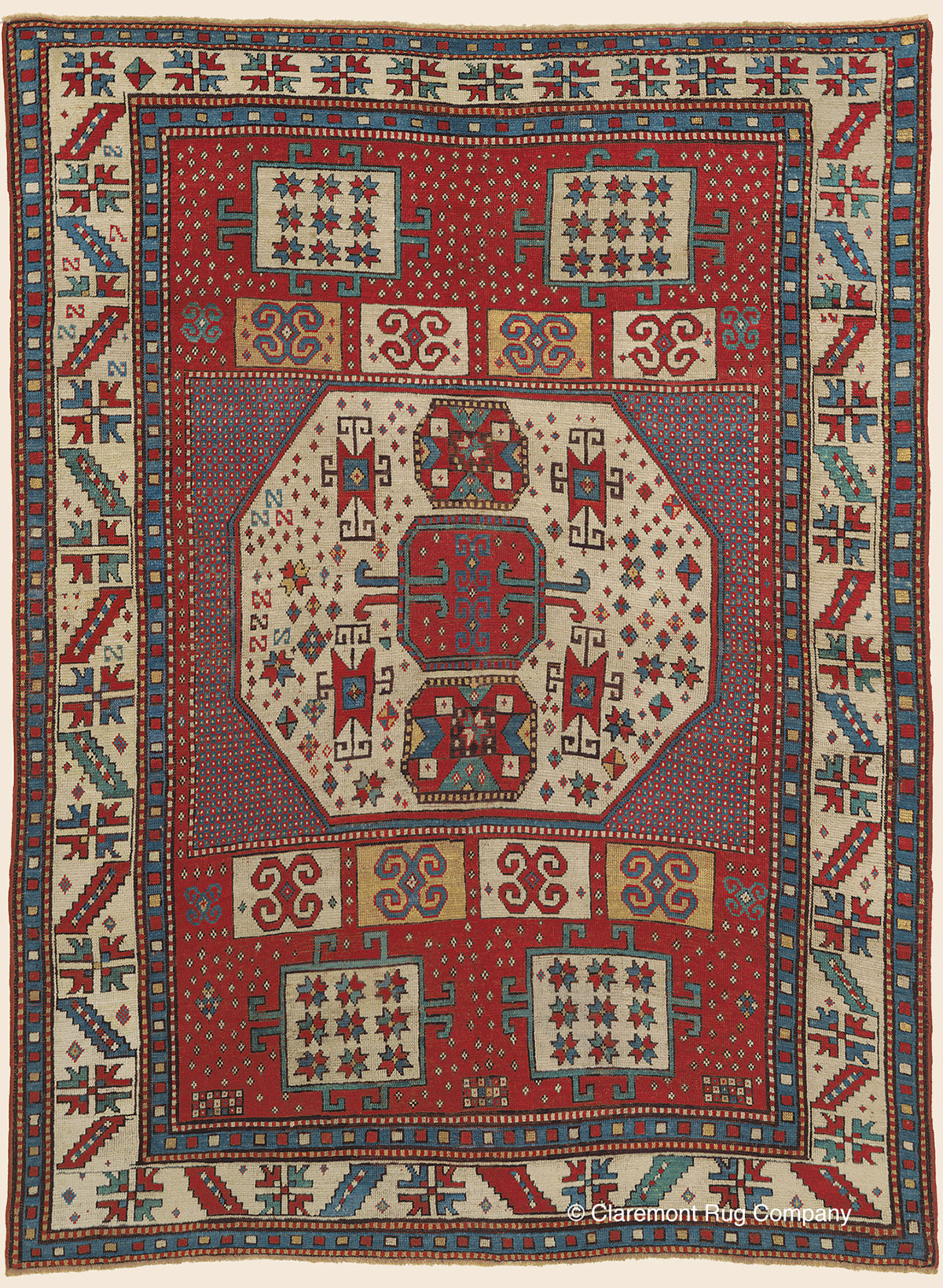 19th century Caucasian Karachov Kazak with allover tribal motifs on a crimson red reserve