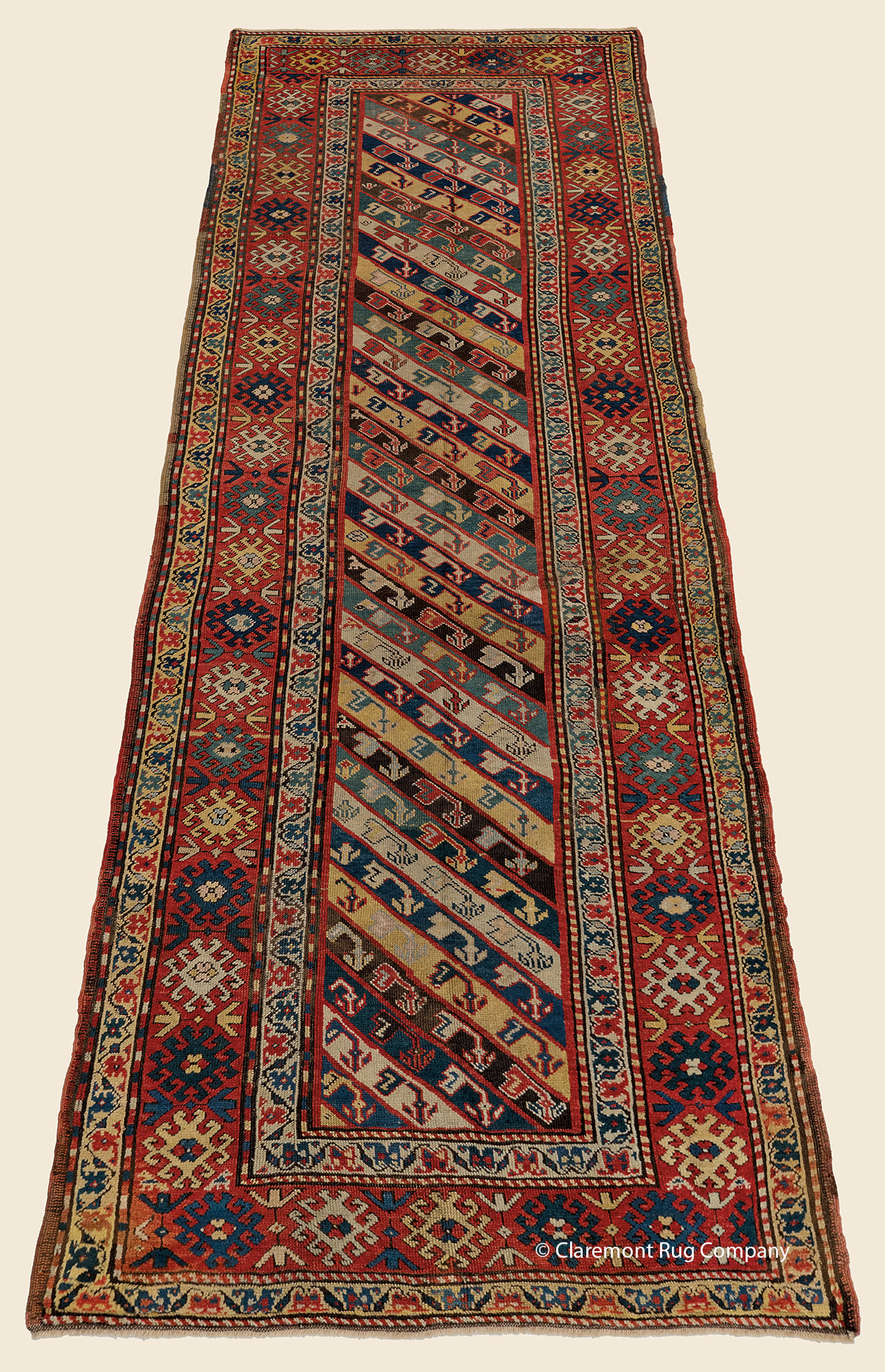 19th century Antique Caucasian Gendje Runner with diagonal stripes and latchhook border