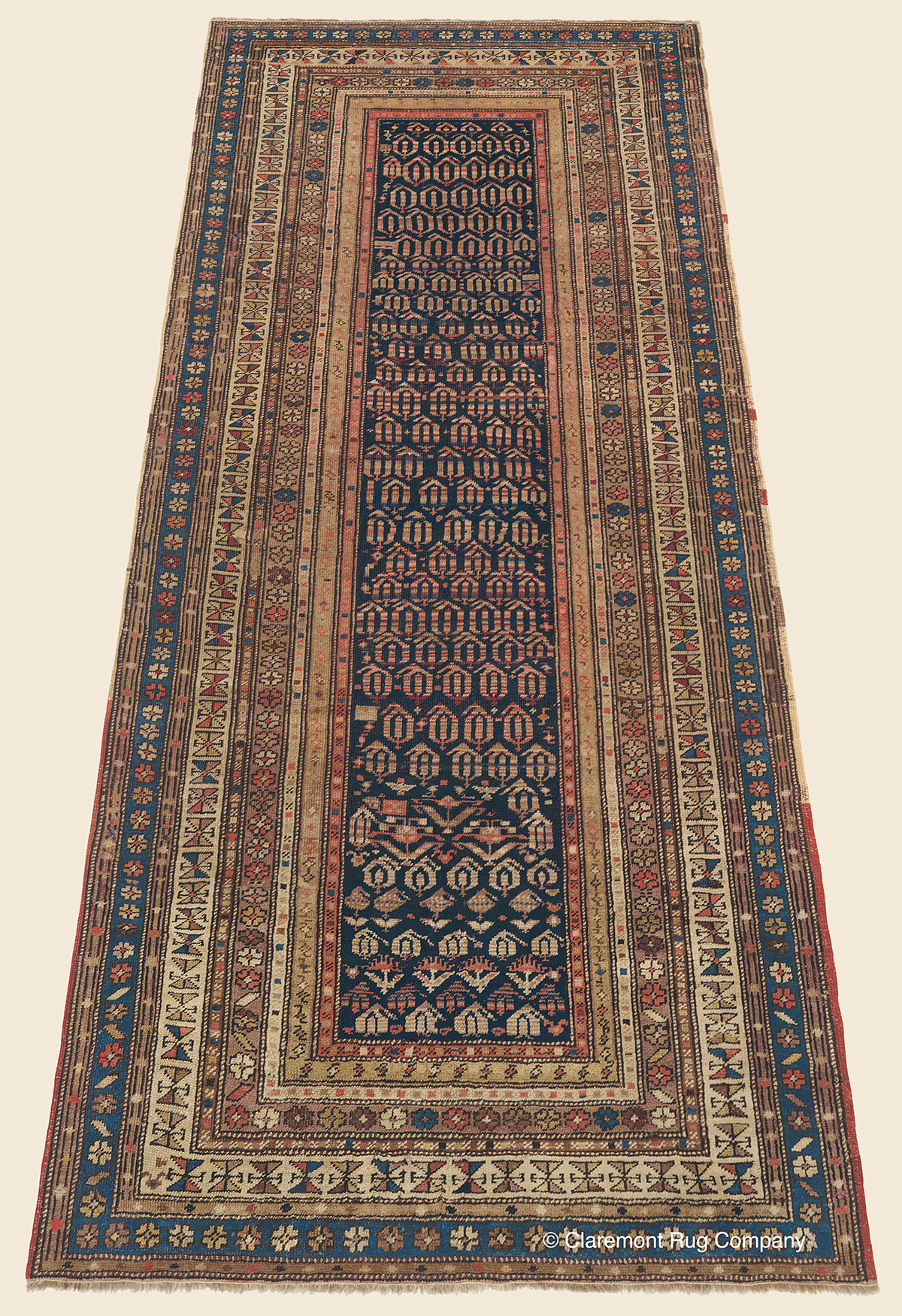 Late 19th century Caucasian Shirvan runner with Boteh design on a midnight indigo reserve