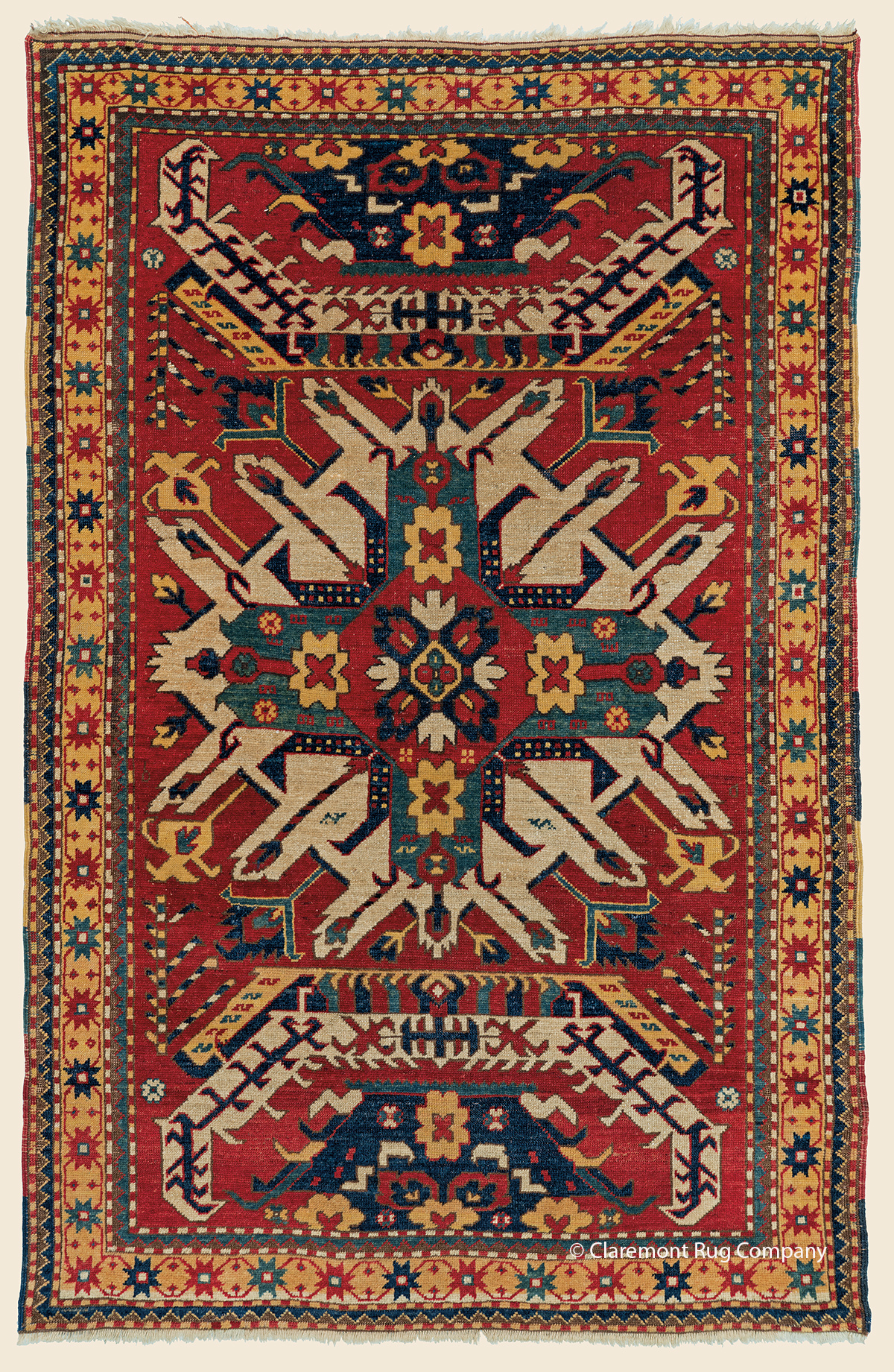 19th century Antique Caucasian Eagle Kazak with Sunburst medallion and abrash red ground