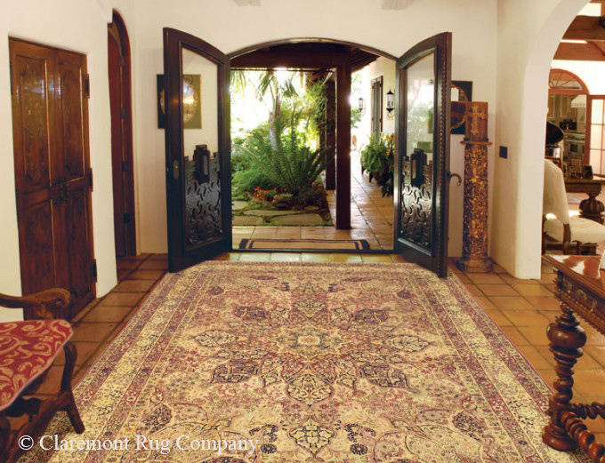Antique Laver Kirman rug in entryway