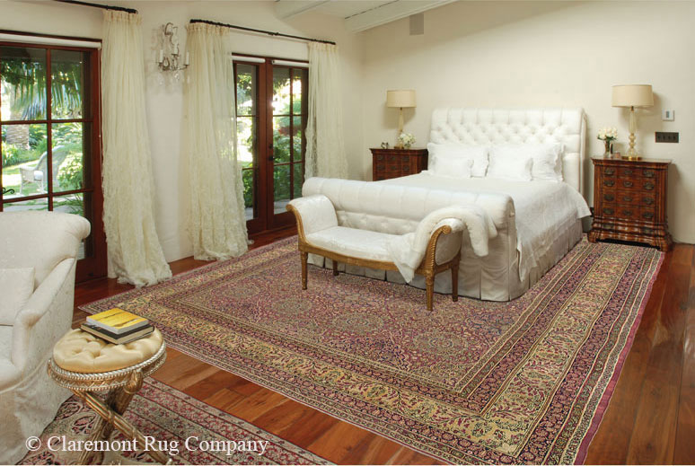 Part of a whole home display in a Spanish colonial residence, two mid-19th century Laver Kirmans under bed and in the sitting area are the art in this elegant master bedroom. Design: Planter & Co