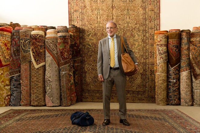 Jan David Winitz in front of Antique Persian Rugs