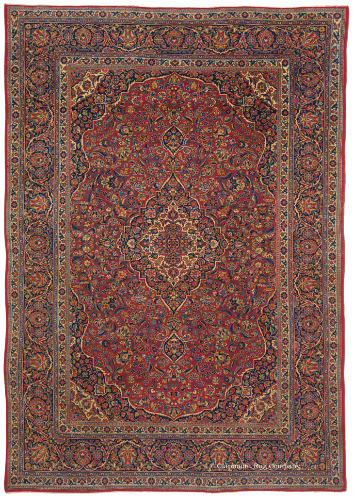 Persian Dabir Kashan antique rug in red tones