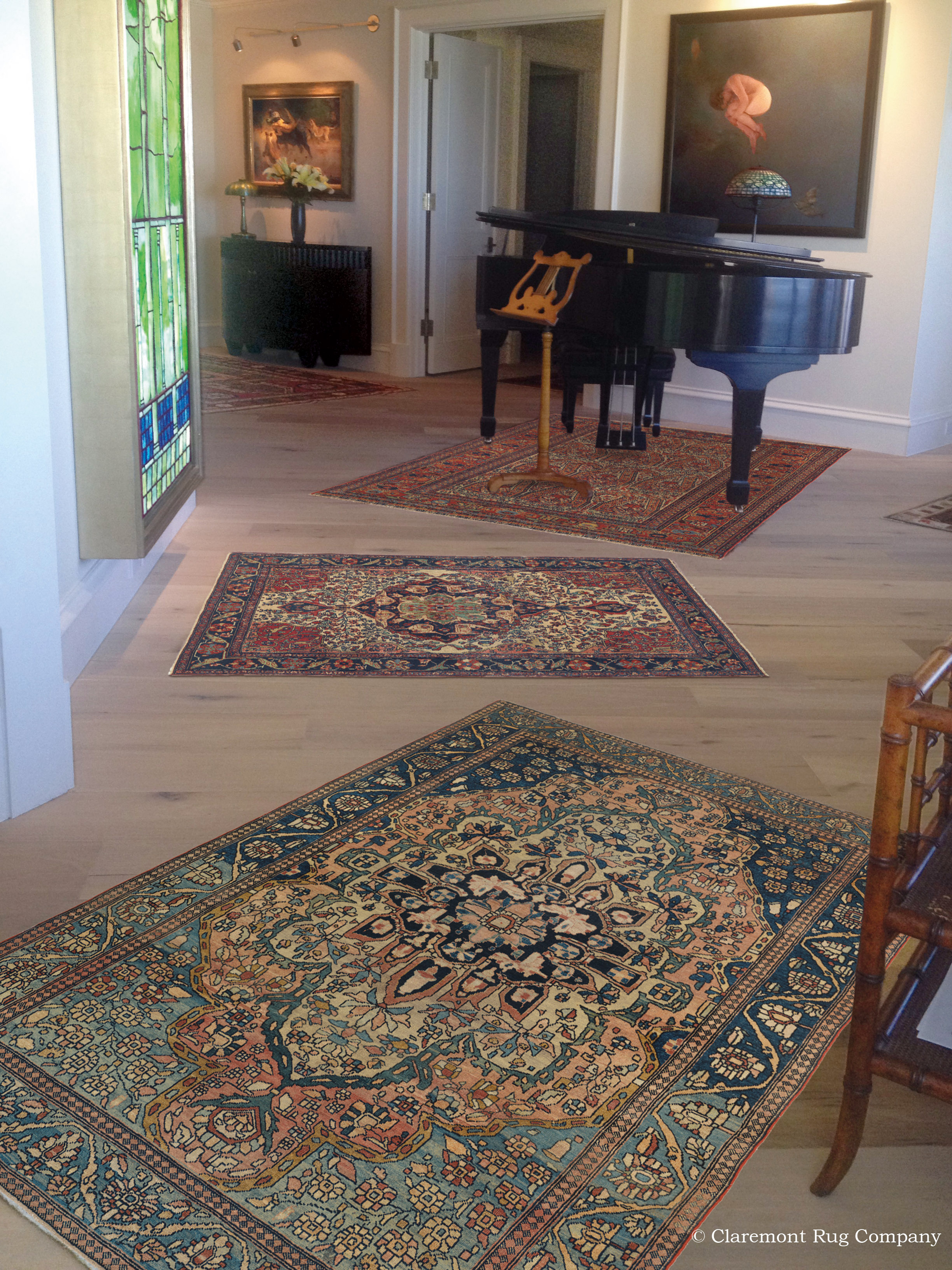 Four Singular Area Size Antique Persian Rugs In An