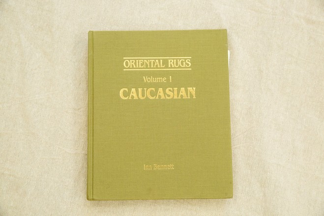Mr. Winitz usually travels with this heavy volume: 'Oriental Rugs: Volume I: Caucasian.'