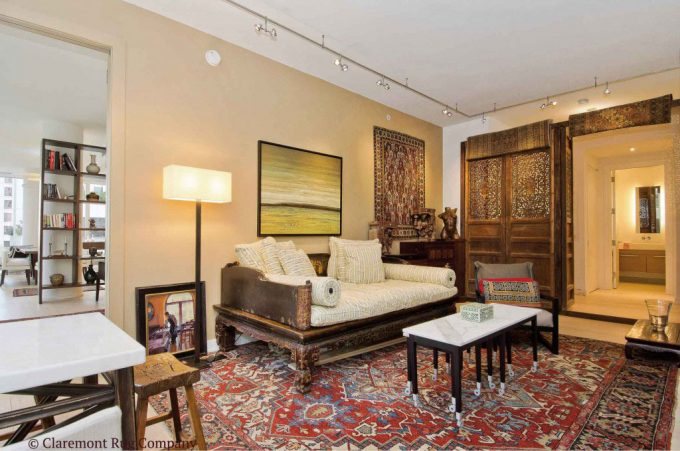 Antique Carpets in San Francisco Contemporary Den wooden doors open serapi antique rug and Caucasian rug on wall