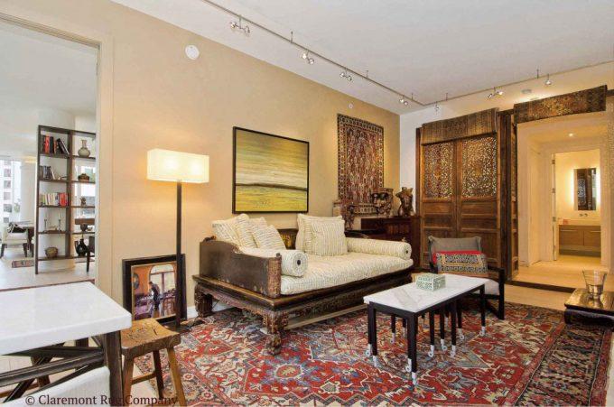 Antique-Carpets-in-San-Francisco-Contemporary-Den-wooden-doors-open-serapi-antique-rug-and-caucasian-rug-on-wall