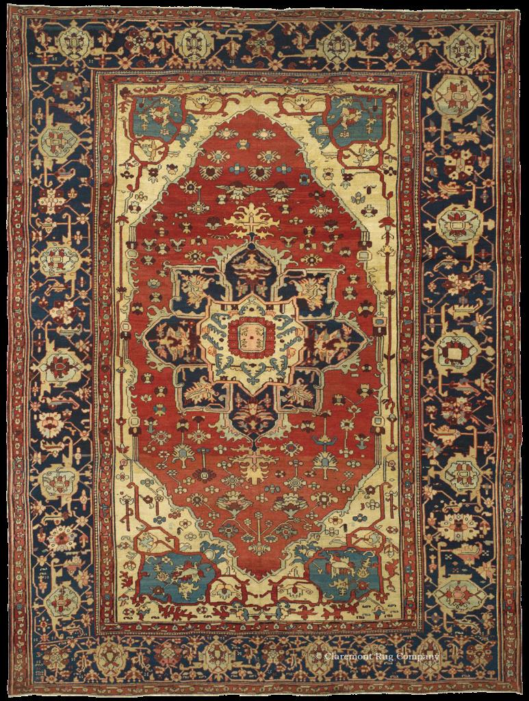 A room-sized Antique Serapi carpet