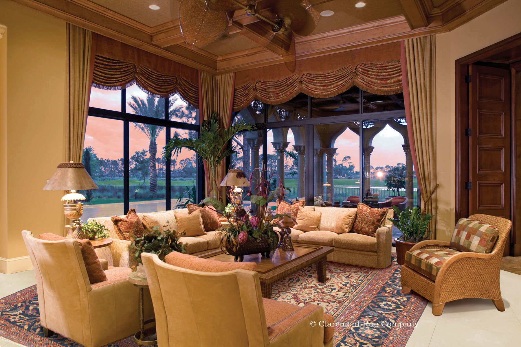 Ivory ground antique Persian Sultanabad in Florida sunroom.
