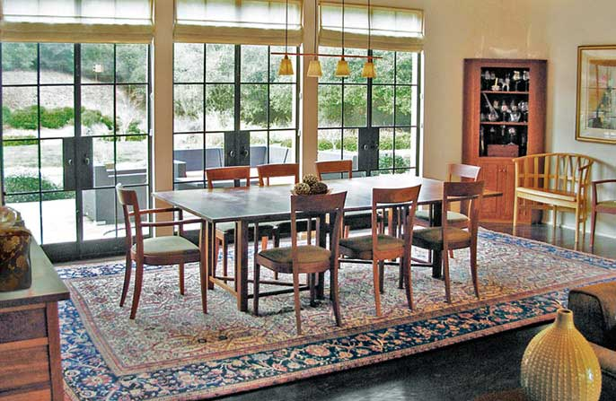 A Sultanabad Persian Rug in a dining room