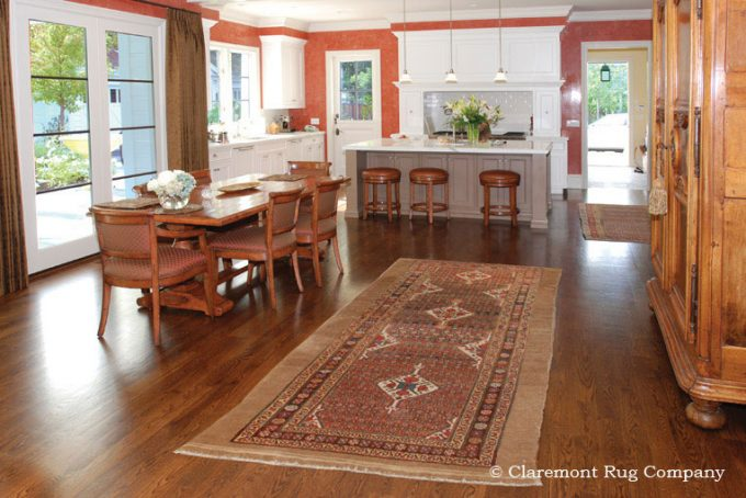 Antique Rug Persian camelhair carpet in traditional kitchen of Silicon Valley California home