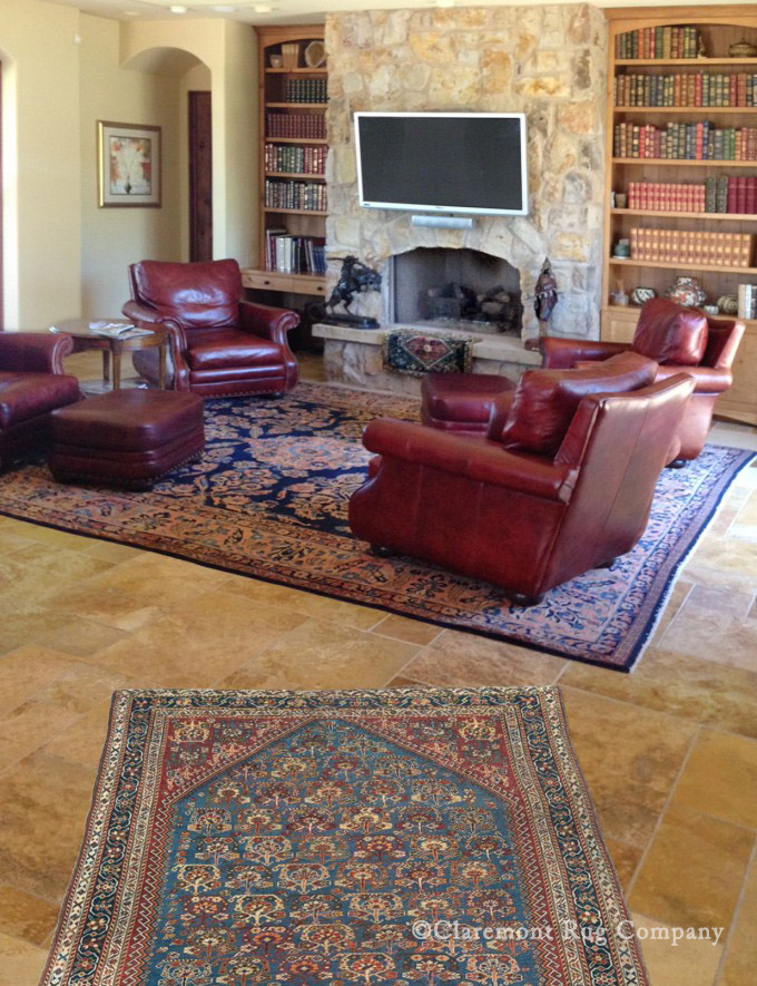 Qashqai & Mahajiran Sarouk in home library with fireplace