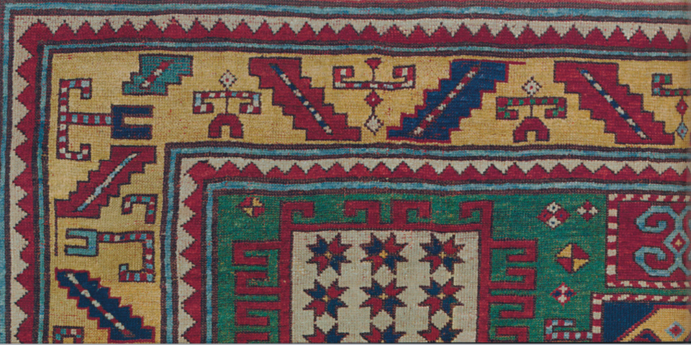 "One commonly employed symbol, ""The Mountain"", is represented in a sharp zigzag line often seen in the rug's guard border."