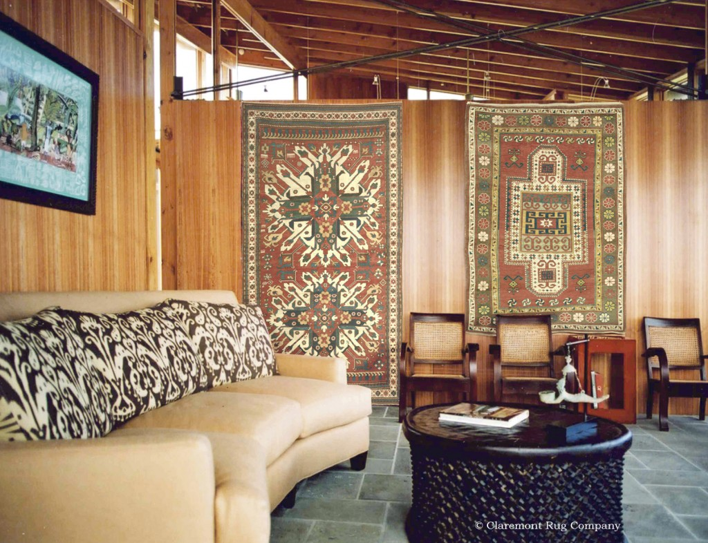 A Pair of Tribal Antique Caucasian Rugs on the Wall