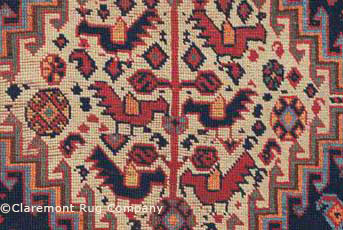 detail of chickens in antique Qashqai rug