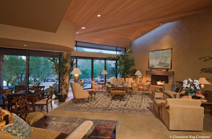 Ferahan Sarouk and Bakshaish antique carpets in a contemporary great rom in a desert home