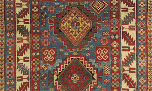 Detail of an antique caucasian kazak rug