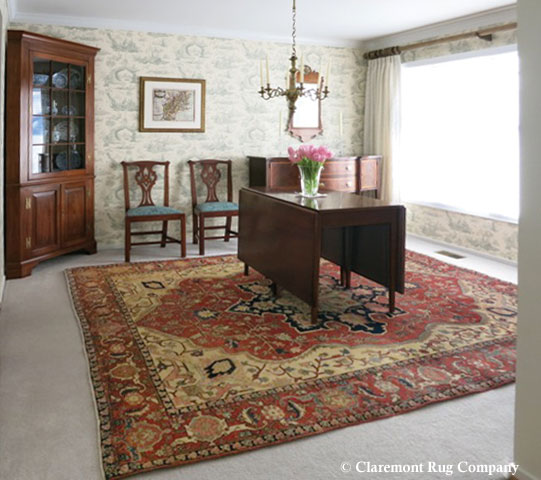 Persian Serapi antique rug in a colonial style dining room