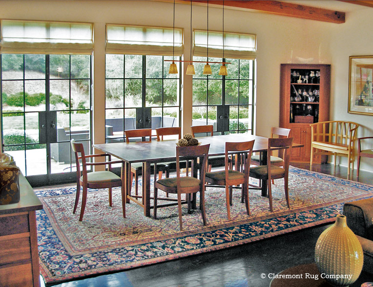 Antique Serapi Carpet Defines Dining Room Space