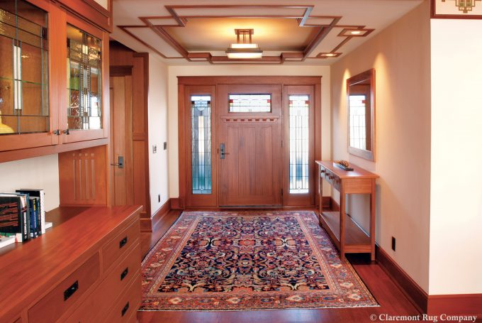 A Sultanabad Oriental Rug adds warmth to the entryway in this frank lloyd wright inspired home