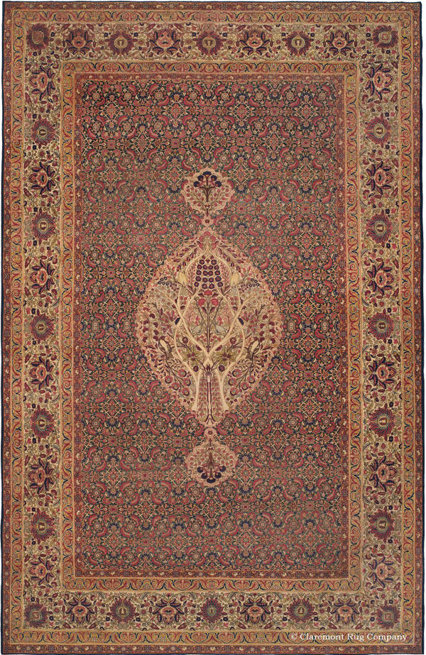 Click to learn more about this world-class Southeast Persian Laver Kirman Antique Rug