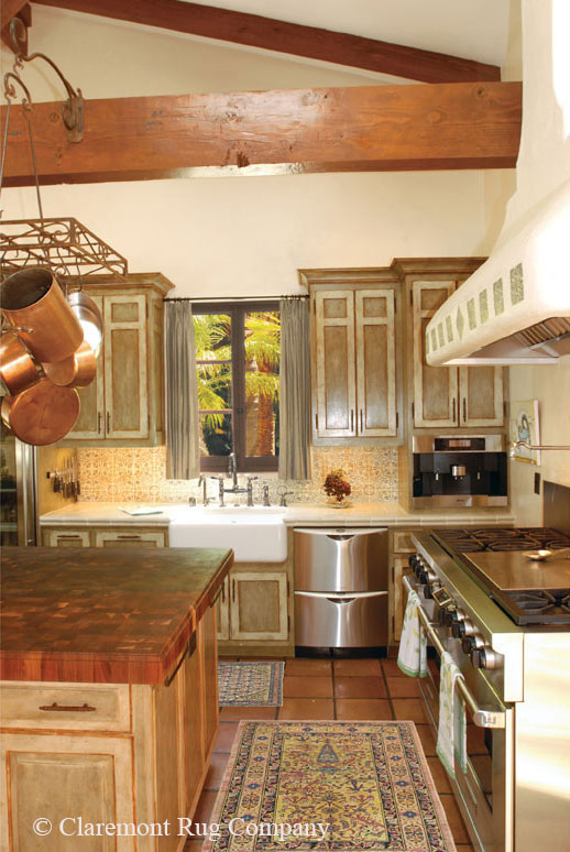 2 antique persian rugs add color to this kitchen