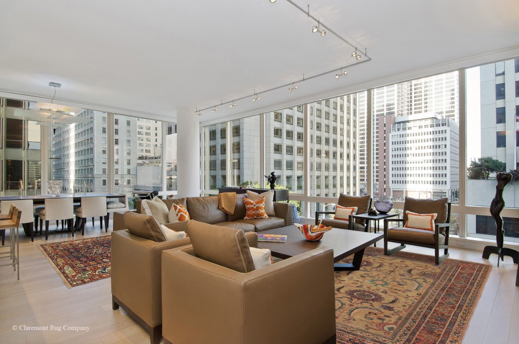 Antique Persian Carpets define space in this contemporary condo