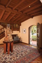 Los Angels California Spanish Home with modern sculpture and Persian Isfahan antique rug in entryway
