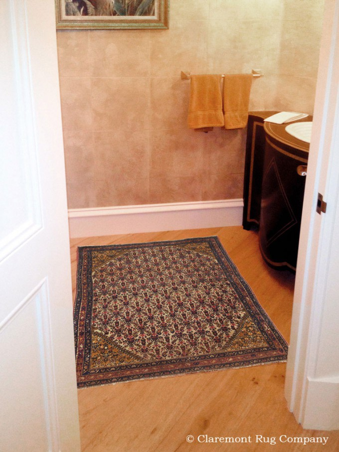Malayer Antique Rug in a powder room