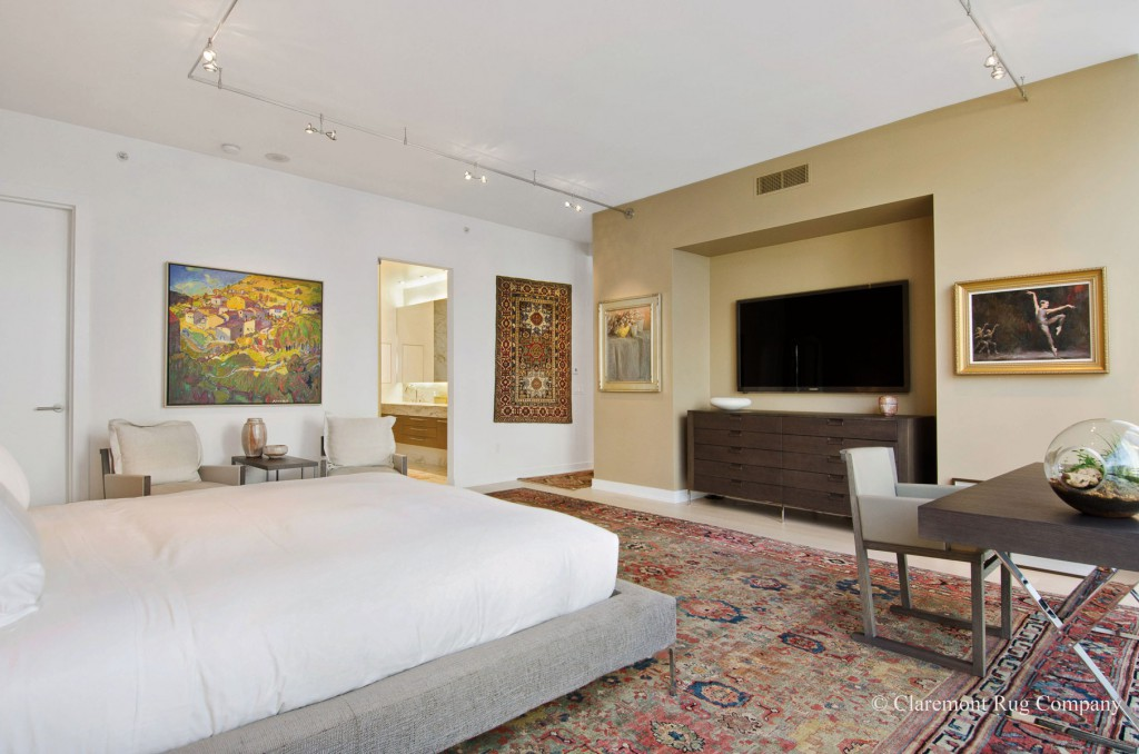 Master Bedroom with a rare jade green sultanabad antique rug in urban condo