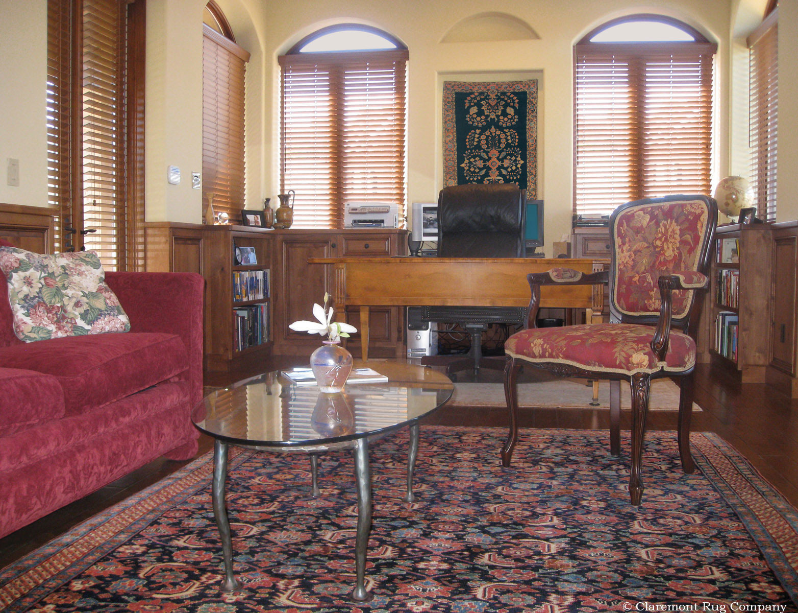Antique Persian Rugs Displayed On Both Wall And Floor