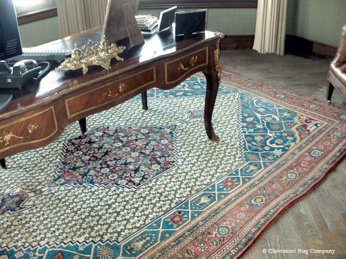 An antique Bijar Persian rug pairs well with an antique desk