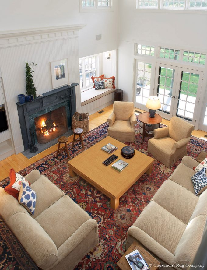 Oversize Persian Sultanabad antique rug in Traditional New York living room