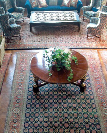 Antique Oriental rugs in large living room