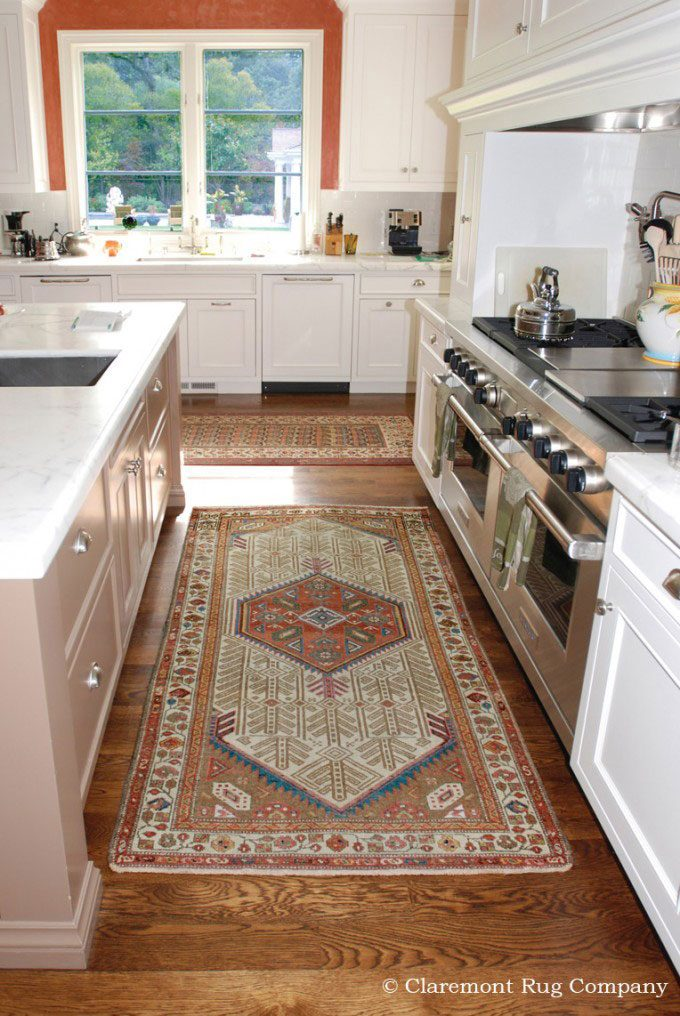 Persian Antique Rugs in Kitchen of silicon valley home Serab Camelhair and Caucasian carpets