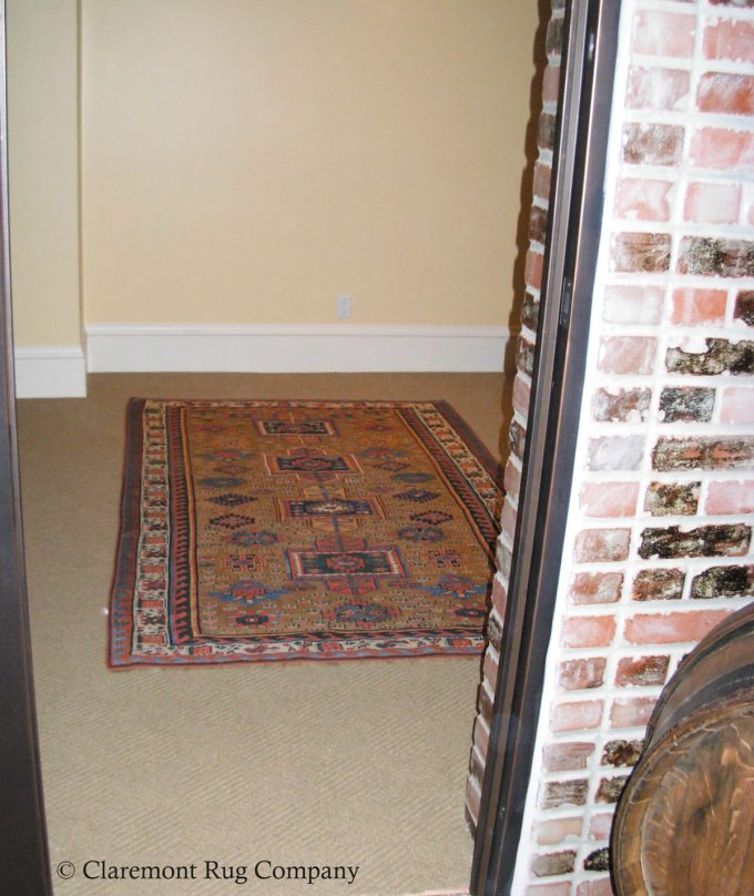 Antique Persian Bakshaish Camelhair Antique Carpet in wine cellar of Silicon Valley home