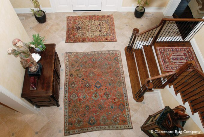 Antique Persian Bakshaish and Serapi Antique Rugs in Entryway of traditional Silicon Valley home