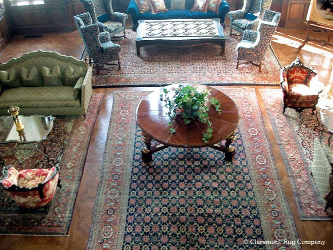 Suite of Antique Persian Rugs in an elegant great room