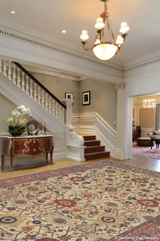 Persian Ivory Sultanabad Antique Rug in a grand traditional foyer
