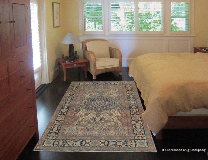 A Persian Kashan antique rug in a peaceful bedroom