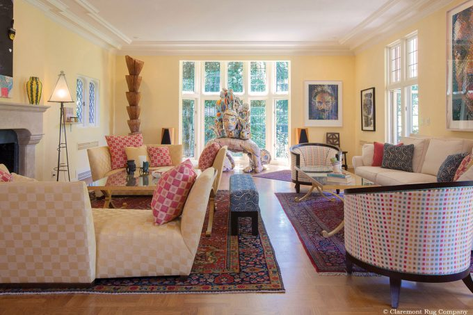 Persian Kashan antique rugs and contemporary art in modern Los Angeles California living room