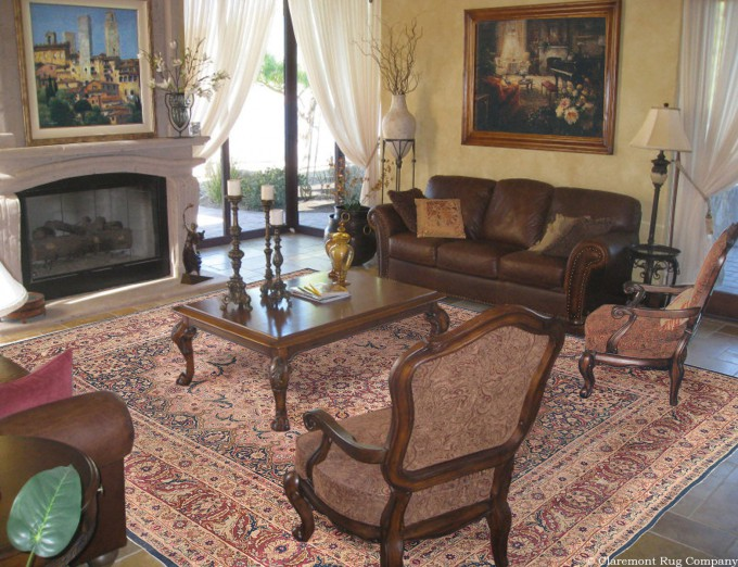 An Antique Persian Oriental Collectible Laver Kirman rug in a traditional living room