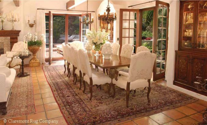 Persian Laver Kirman Antique rug in Los Angeles California Spanish Colonial Dining Room