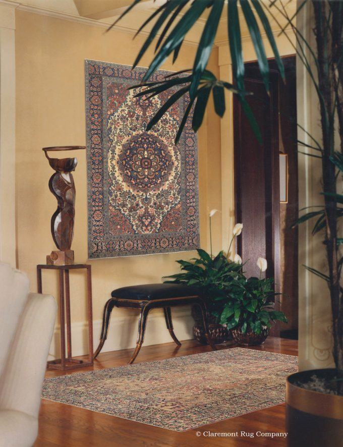 Antique Persian Laver Kirman and Ferahan Sarouk antique rugs on wall as art in modern philadelphia home