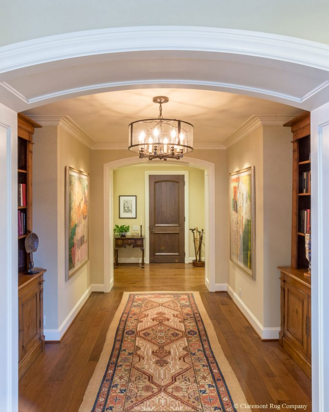 Persian Serab Camelhair runner Antique Rug in hallway of traditional Houston Texas penthouse