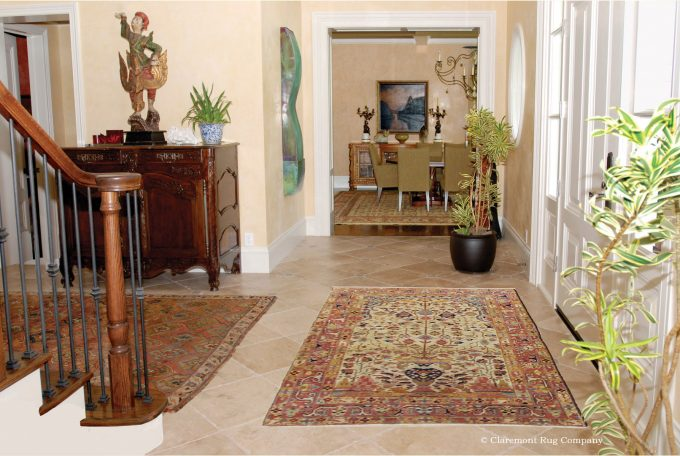 Persian-Serapi-vase-antique-rugs-in-entry-hall-of-traditional-Silicon-Valley-home